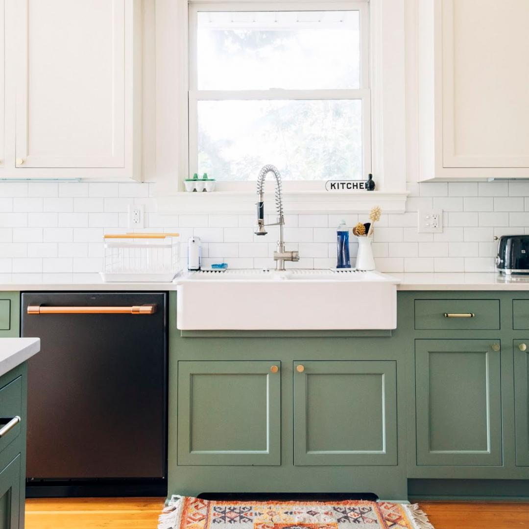 Green cabinets and matte black dishwasher